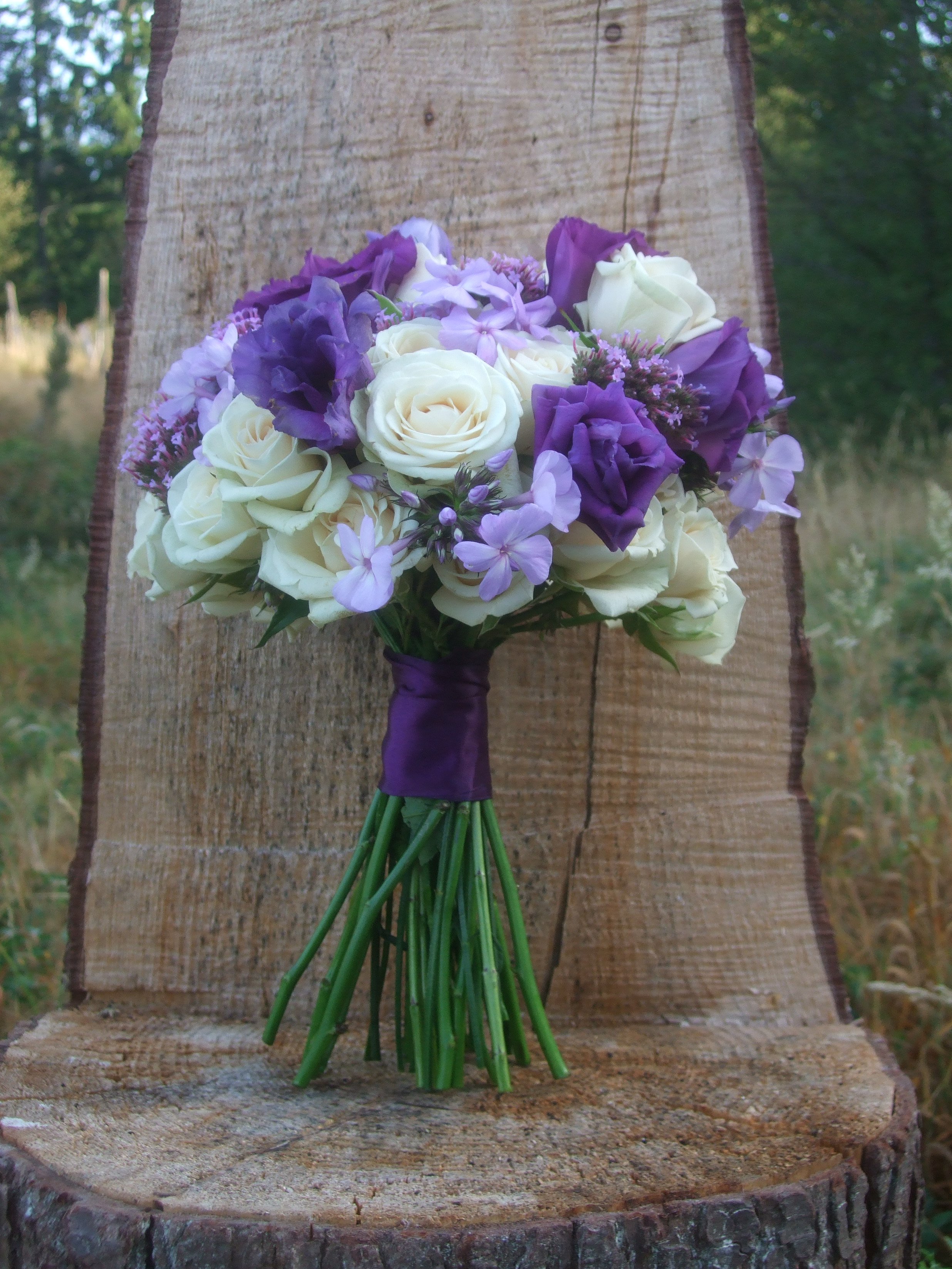 Image of bridal bouquet by Vases Wild in purple and cream theme