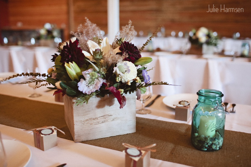 image of wedding centerpiece red dahlia autumn leaves wooden box