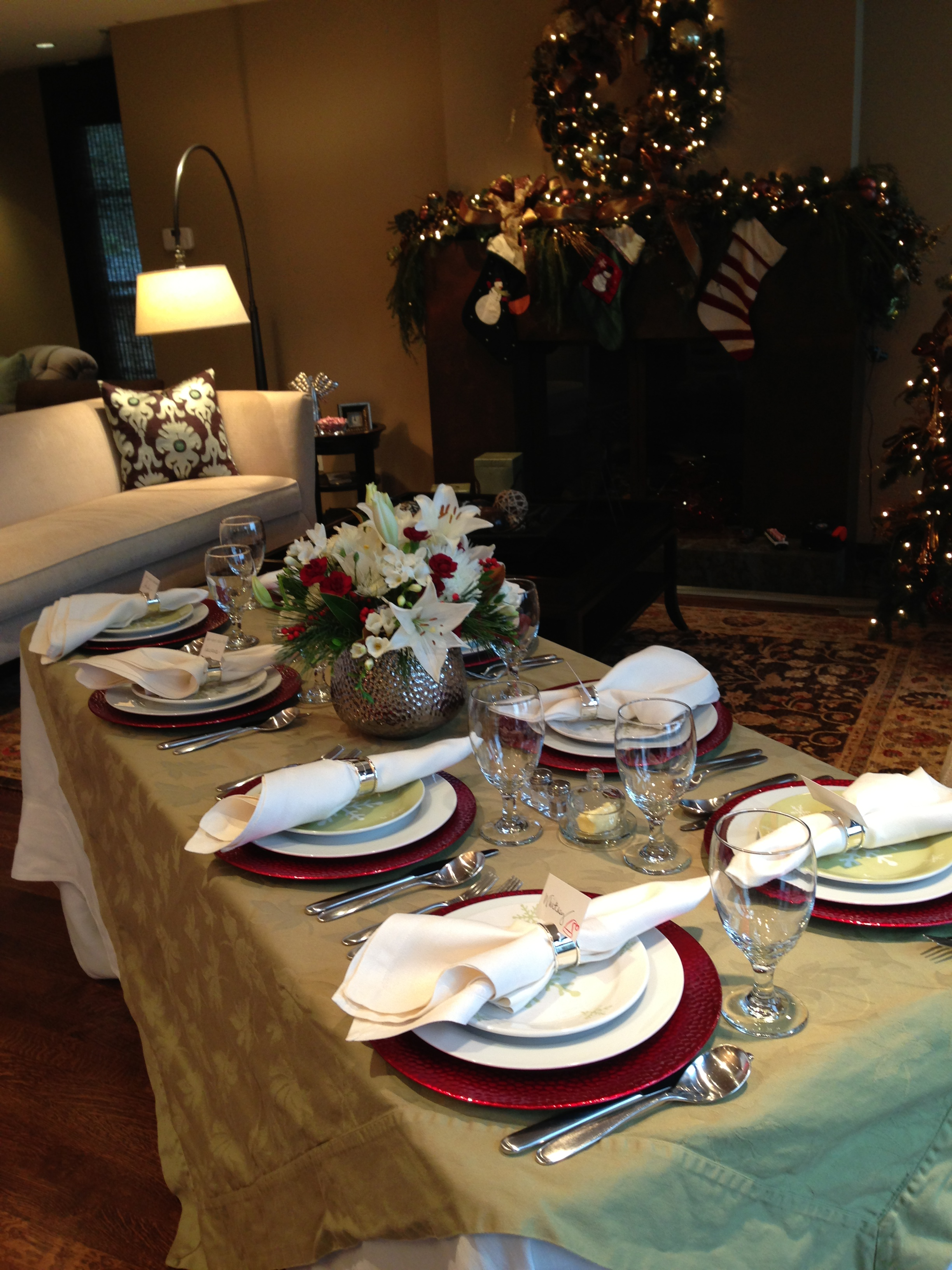 image of table set for christmas with golds and cranberries