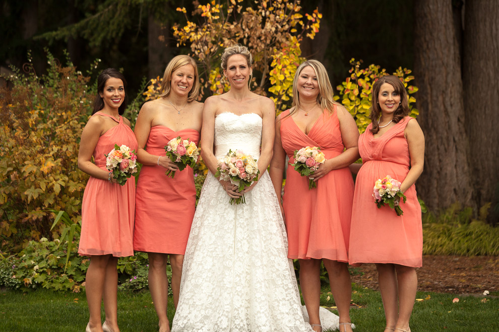 image of bridesmaids in peach pink dresses with bridal bouquets