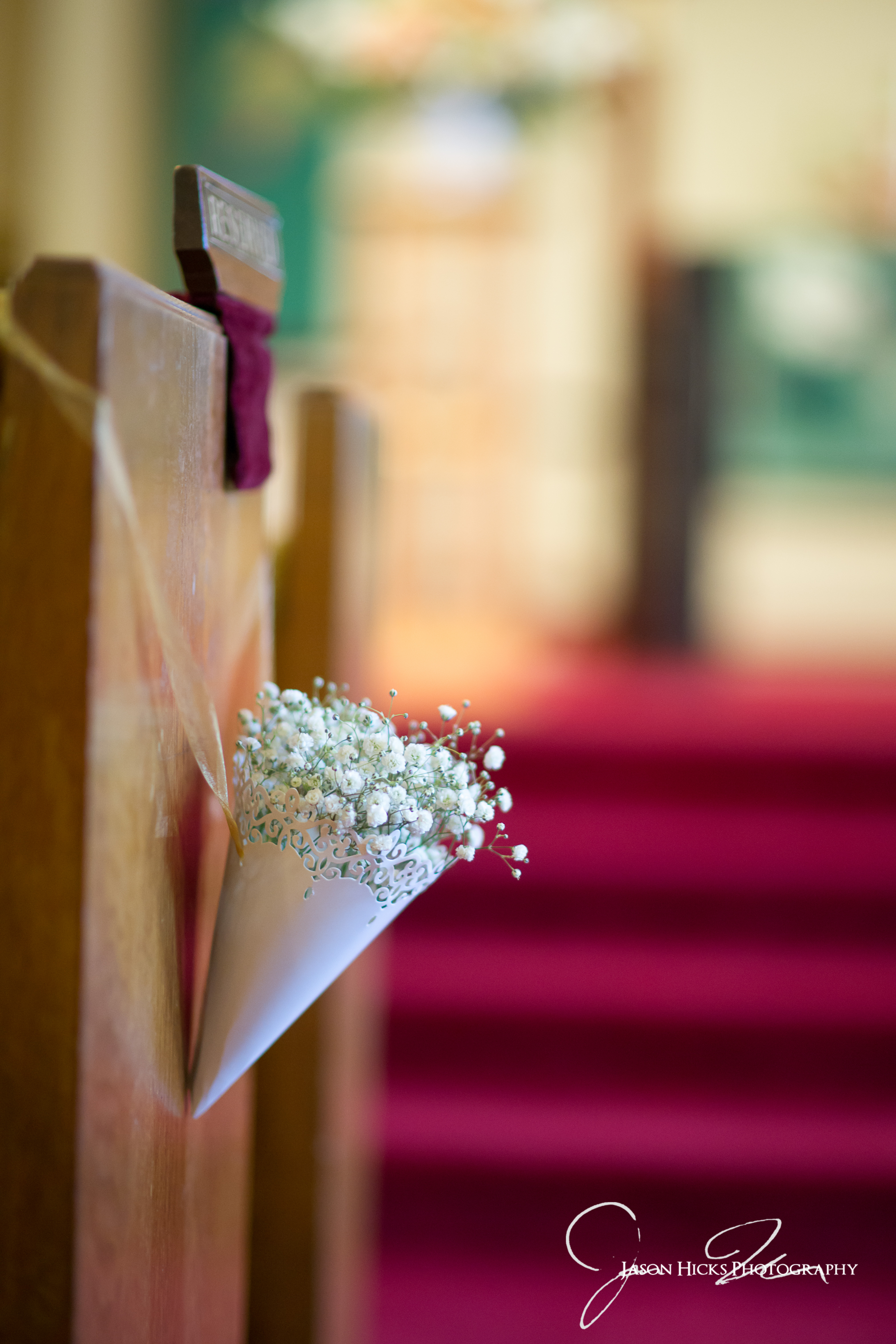 image of pew cone with babys breath