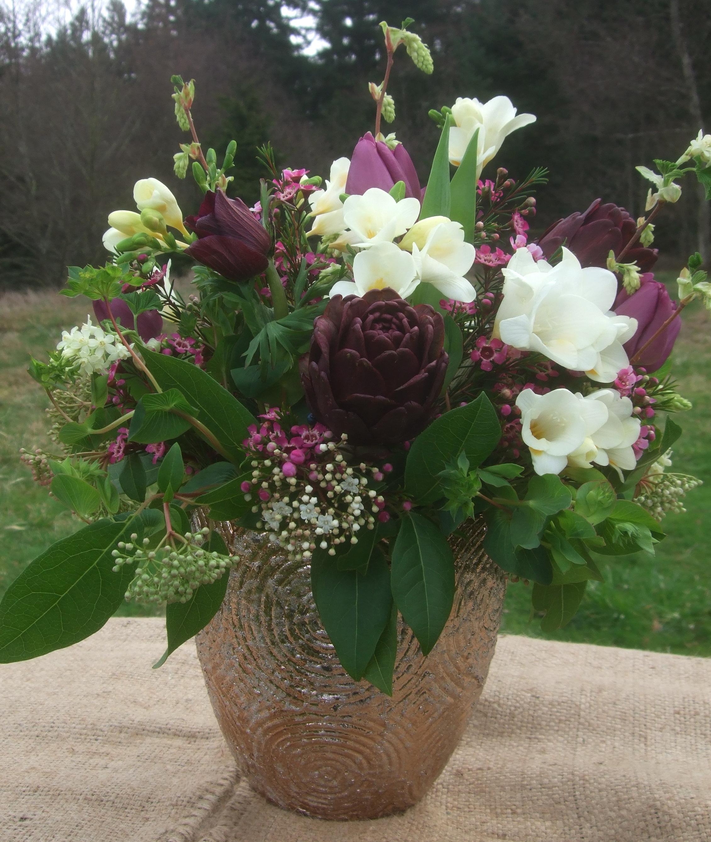 image of plum and white centerpiece in metallic vase