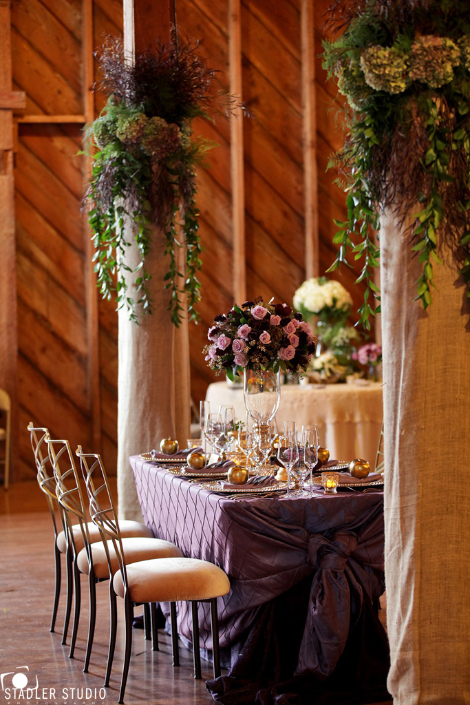 Elegant gold and purple wedding table decor takes barn weddings ...