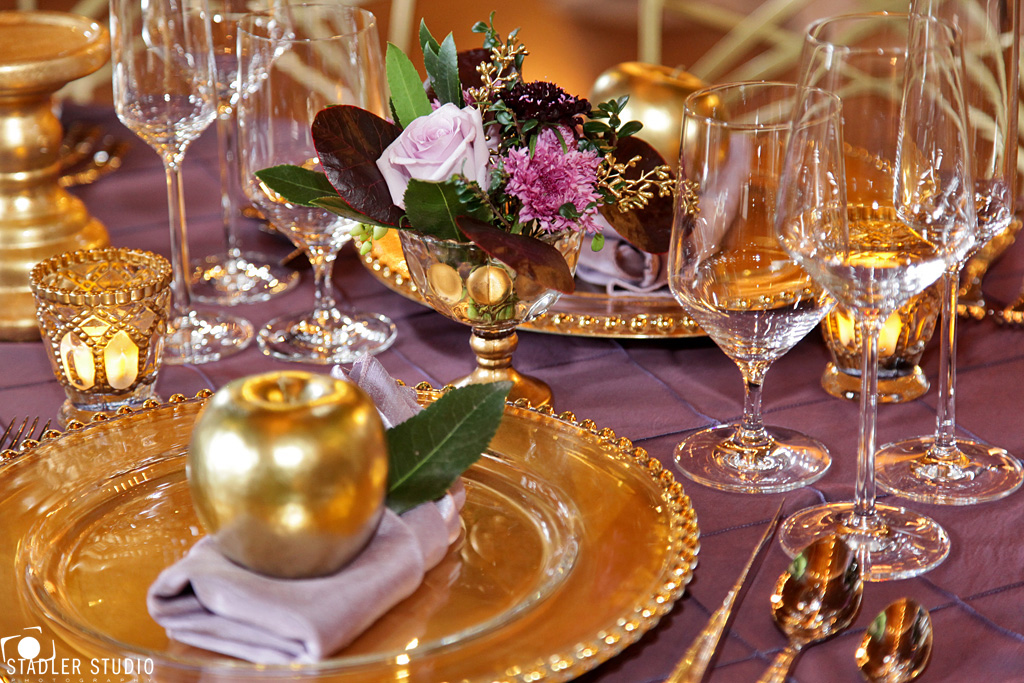 Elegant gold and purple wedding table decor takes barn weddings golden apple with orchid linens and a beaded glass charger junglespirit