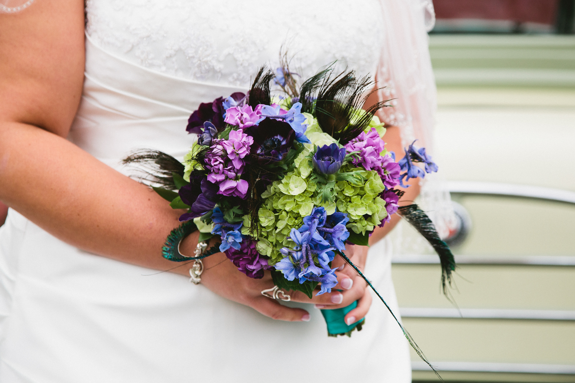 peacock theme bridal bouquet in blue, purple and green