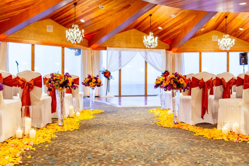 Seattle wedding at The Edgewater ceremony flowers in purple and orange with Roses and Lilies