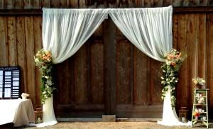 barn door drapes with floral tiebacks