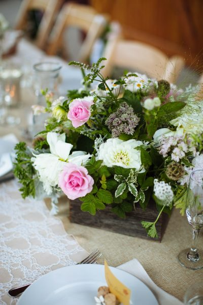 Barnwood box centerpiece with blush and white flowers for a rustic wedding on Whidbey Island