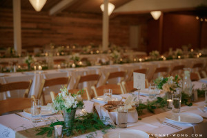 Whidbey Island wedding at fireseed catering with flowers by vases wild