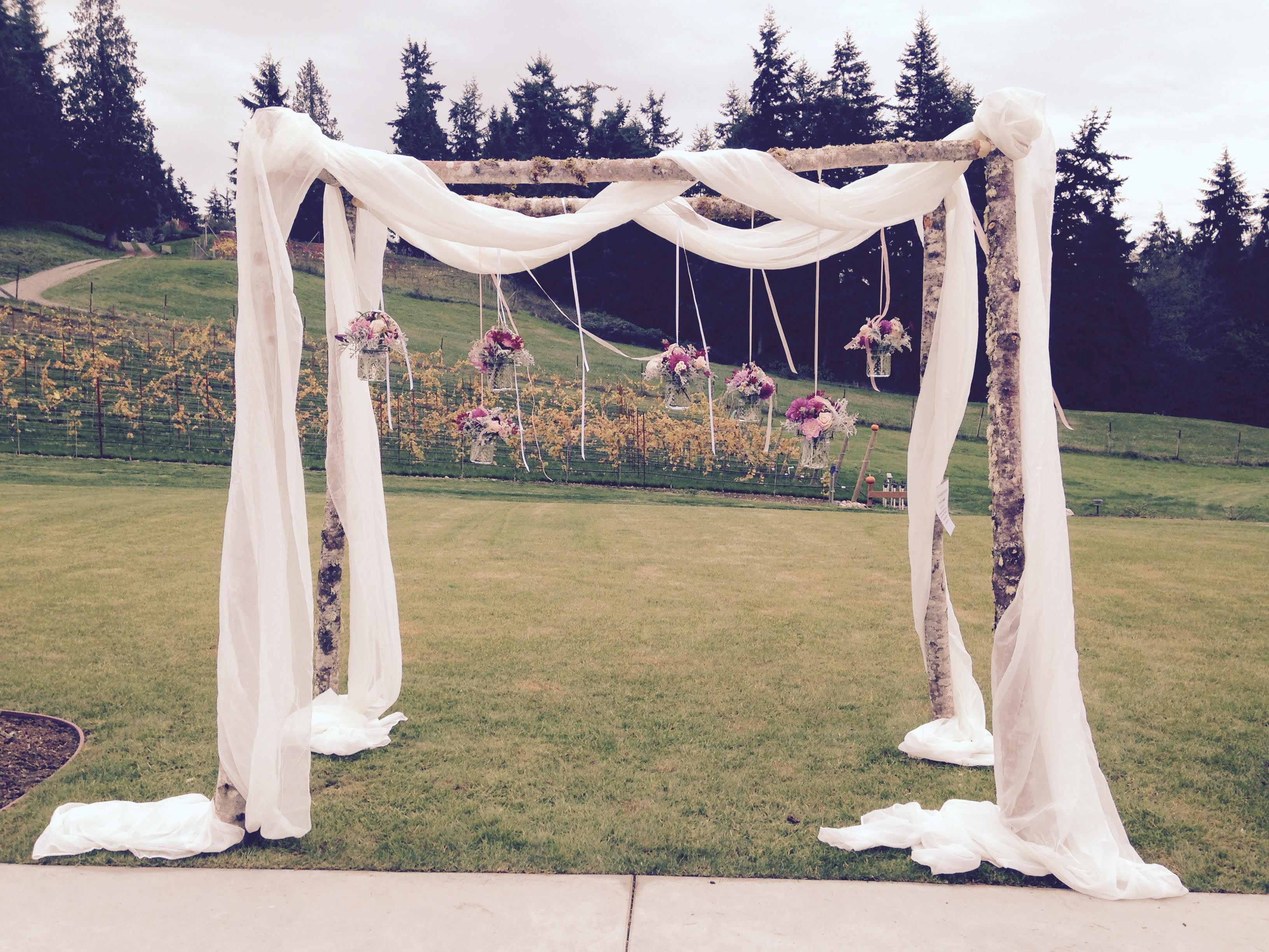 Wedding arbor for rent tobey nelson weddings events wedding arbor decorated with hanging vases of pink and purple reviewsmspy