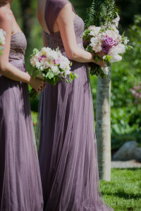 Bridesmaids with blush and lavender bouquets