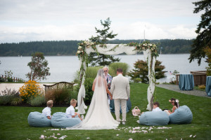 Whidbey Island wedding ceremony with arbor
