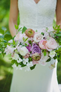 Bridal bouquet with blush and lavender roses, sweet peas, and vintage Ranunculus