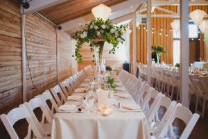wedding long tables by vases wild image by julianna rennard