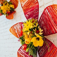 yarn flower wall installation with fresh flower center