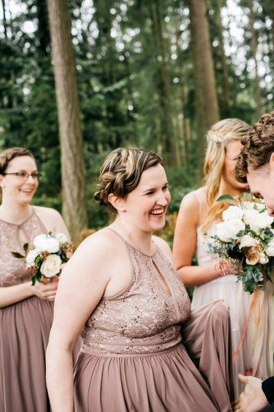 Bridesmaids with spring wedding flower bouquets