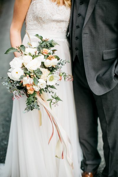 Spring bridal bouquet in white, blush and neutral with Ranunculus and Anemone
